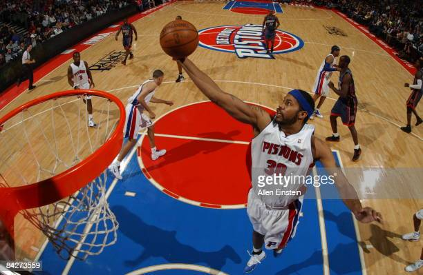 Rasheed Wallace of the Detroit Pistons pulls in a rebound during a game against the Charlotte Bobcats in a game at the Palace of Auburn Hills on...