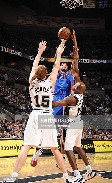 Rasheed Wallace of the Detroit Pistons shoots against Matt Bonner and Jacque Vaughn of the San Antonio Spurs at the ATT Center December 2 2008 in San...