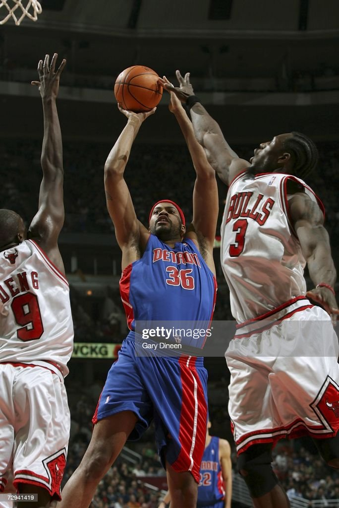 Rasheed Wallace #36 of the Detroit Pistons shoots between Luol Deng #9 and Ben Wallace #3 of the Chicago Bulls January 6, 2007 at the United Center in Chicago, Illinois.