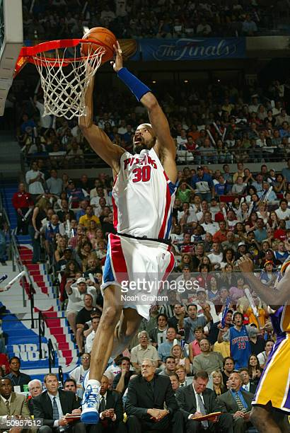 Rasheed Wallace of the Detroit Pistons slam dunks the ball against the Los Angeles Lakers during Game Four of the 2004 NBA Finals June 13 2004 at the...