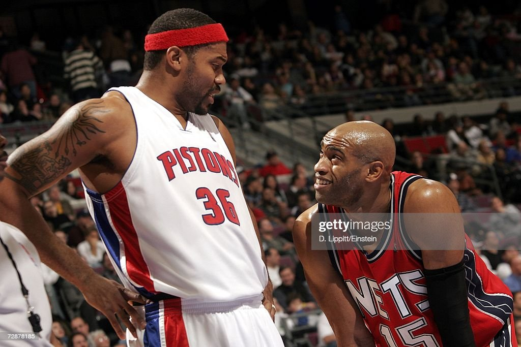 Rasheed Wallace #36 of the Detroit Pistons talks with Vince Carter #15 of the New Jersey Nets on December 26, 2006 at the Palace of Auburn Hills in Auburn Hills, Michigan. The Pistons defeated the Nets 92-91.