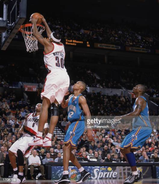 Rasheed Wallace of the Portland Trail Blazers goes up for the dunk over PJ Brown of the New Orleans Hornets during the game at The Rose Garden on...
