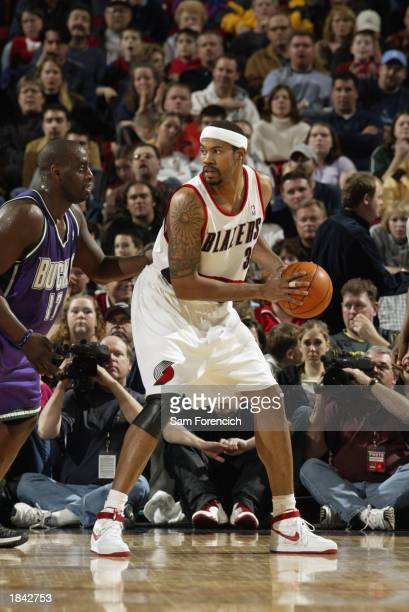 Rasheed Wallace of the Portland Trail Blazers looks to pass while defended by Anthony Mason of the Milwaukee Bucks during the NBA game at The Rose...