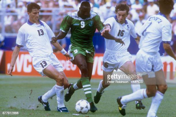 Rasheed Yekini Nigeria goes past Italy's Dino Baggio and Roberto Donadoni