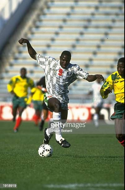 Rasheed Yekini of Nigeria trying to score during a match Mandatory Credit Shaun Botterill/Allsport