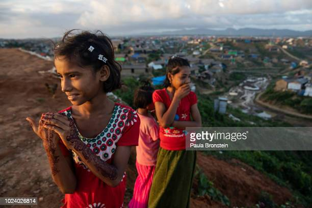 Rasheeda stands on hill with friends in Balukhali camp on August 26 2018 in Cox's Bazar Bangladesh A year ago Myanmar's military crackdown on the...