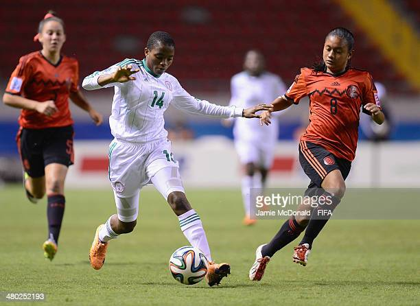Rasheedat Ajibade of Nigeria battles with Cinthia Huerta of Mexico during the FIFA U17 Women's World Cup Group D match between Nigeria and Mexico at...