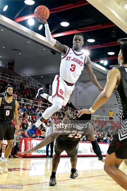 Rasheem Dunn of the St. John's Red Storm attempts a shot against Tamenang Choh of the Brown Bears at Carnesecca Arena on December 10, 2019 in New...