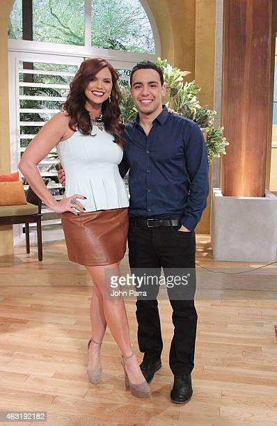 Rashel Diaz and Actor Victor Rasuk pose at Telemundo Studios to promote Fifty Shades Of Gray at Telemundo Studio on February 10 2015 in Miami Florida