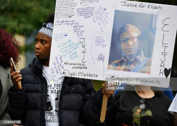 Rashiaa Veal holds a sign of her cousin Elijah McClain at a press conference in front of the Aurora Municipal Center October 01 2019 Family friends...