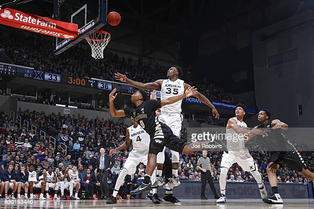 RaShid Gaston of the Xavier Musketeers defends against Brandon Childress of the Wake Forest Demon Deacons in the first half of the game at Cintas...