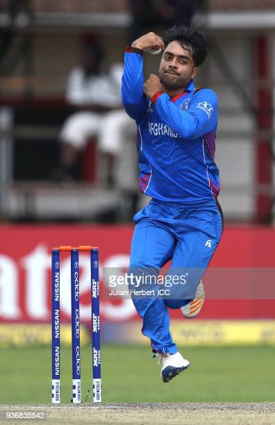 Rashid Khan Arman of Afghanistan bowls during The ICC Cricket World Cup Qualifier between Ireland and Afghanistan at The Harare Sports Club on March...