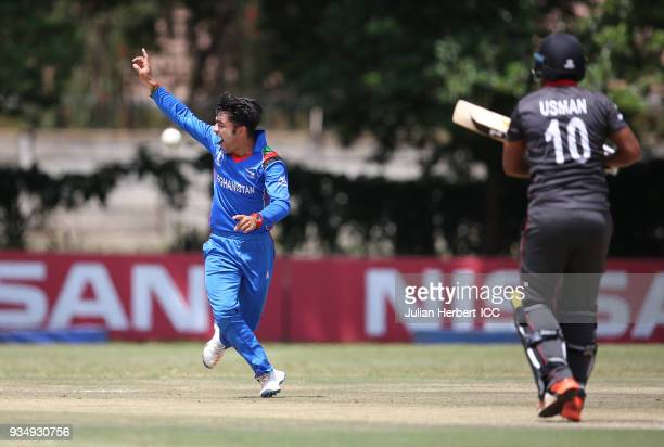 Rashid Khan Arman of Afghanistan susessfully appeals for the wicket Muhammad Usman of The UAE during The Cricket World Cup Qualifier between The UAE...