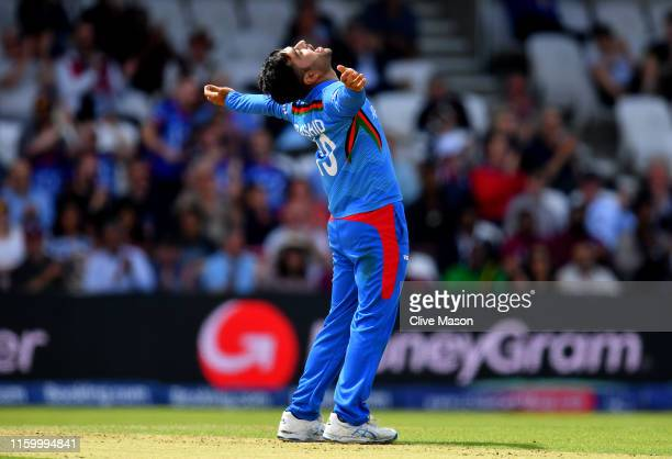 Rashid Khan of Afghanistan celebrates dismissing Evin Lewis of West Indies during the Group Stage match of the ICC Cricket World Cup 2019 between...