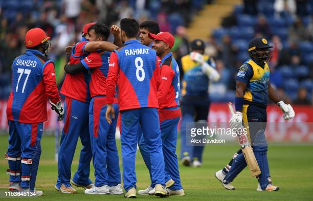 Rashid Khan of Afghanistan celebrates the wicket of Kusal Perera of Sri Lanka with his teammates during the Group Stage match of the ICC Cricket...