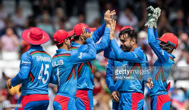 Rashid Khan of Afghanistan celebrates with his team mates after taking the wicket of Evin Lewis of West Indies during the Group Stage match of the...