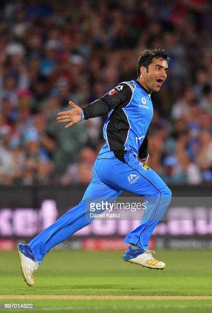 Rashid Khan of the Adelaide Strikers celebrates after bowling out Ben Rohrer of the Sydney Thunder during the Big Bash League match between the...