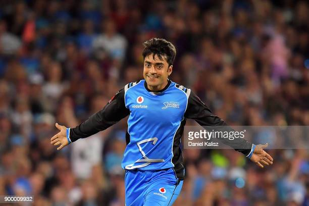 Rashid Khan of the Adelaide Strikers celebrates after taking a wicket during the Big Bash League match between the Adelaide Strikers and the Brisbane...