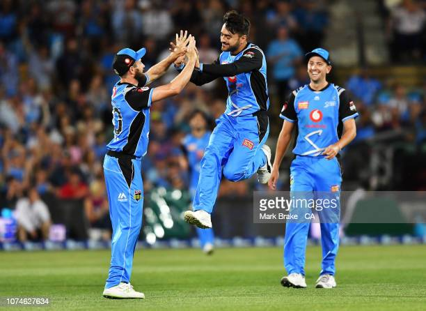 Rashid Khan of the Adelaide Strikers celebrates after taking the wicket of Sam Harper of the Melbourne Renegades during the Adelaide Strikers v...