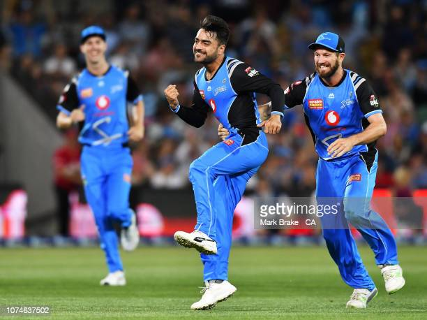 Rashid Khan of the Adelaide Strikers celebrates after taking the wicket of Cameron White of the Melbourne Renegades during the Adelaide Strikers v...