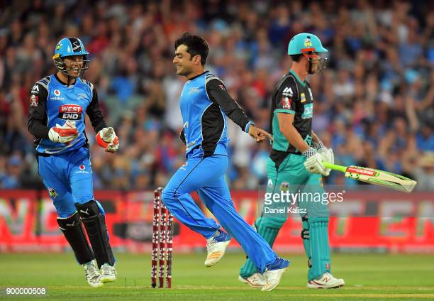 Rashid Khan of the Adelaide Strikers celebrates after taking the wicket of Chris Lynn of the Brisbane Heat during the Big Bash League match between...