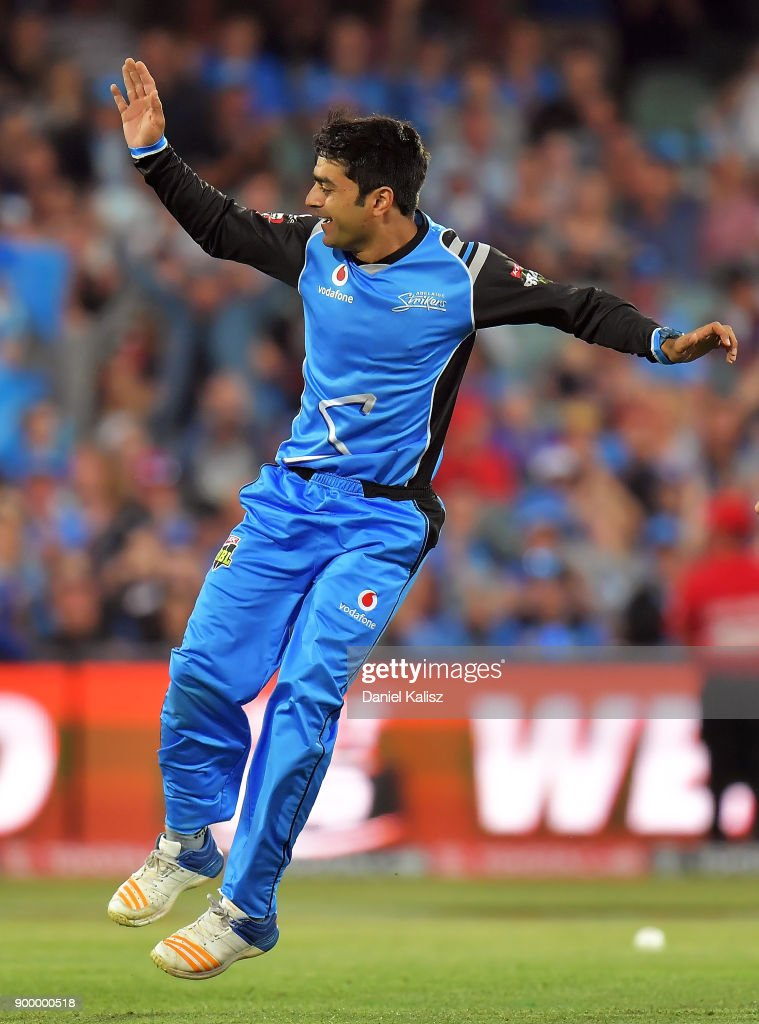 Rashid Khan of the Adelaide Strikers celebrates after taking the wicket of Chris Lynn of the Brisbane Heat during the Big Bash League match between the Adelaide Strikers and the Brisbane Heat at Adelaide Oval on December 31, 2017 in Adelaide, Australia.