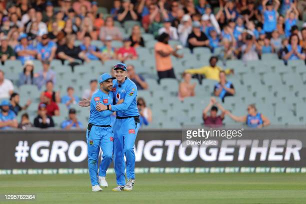 Rashid Khan of the Adelaide Strikers celebrates with Matthew Renshaw of the Adelaide Strikers during the Big Bash League match between the Adelaide...