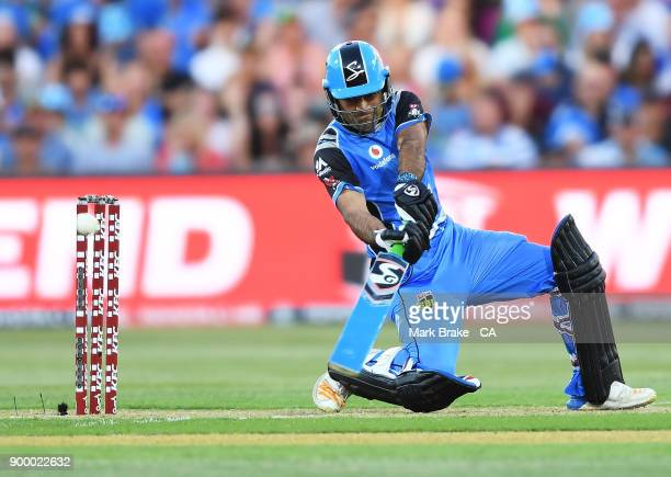 Rashid Khan of the Adelaide Strikers hits a six during the Big Bash League match between the Adelaide Strikers and the Brisbane Heat at Adelaide Oval...