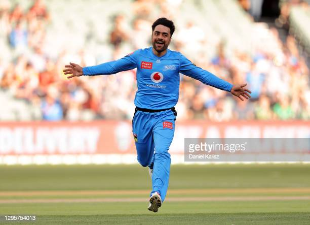 Rashid Khan of the Strikers celebrates after taking the wicket of Glenn Maxwell of the Stars during the Big Bash League match between the Adelaide...
