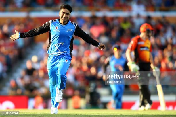 Rashid Khan of the Strikers celebrates the wicket of Ashton Turner of the Scorchers during the Big Bash League match between the Perth Scorchers and...
