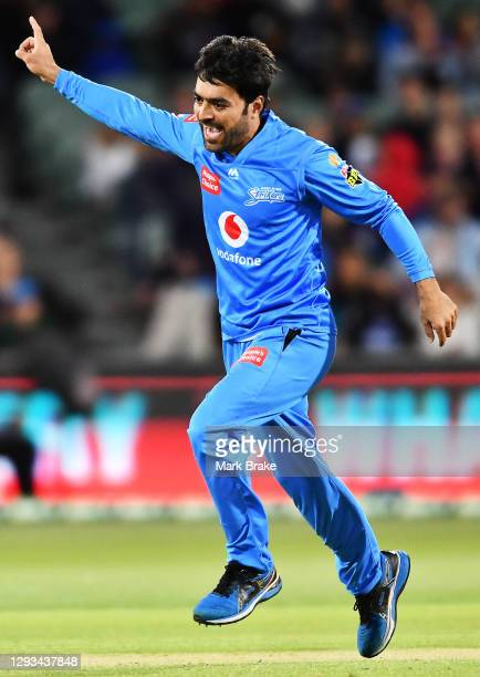 Rashid Khan of the Strikers celebrates the wicket of Chris Munro of the Scorchers during the Big Bash League match between the Perth Scorchers and...