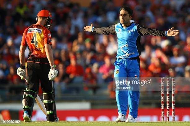 Rashid Khan of the Strikers celebrates the wicket of Hilton Cartwright of the Scorchers during the Big Bash League match between the Perth Scorchers...