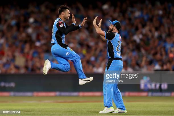 Rashid Khan of the Strikers celebrates the wicket of Sam Harper of the Renegades during the Adelaide Strikers v Melbourne Renegades Big Bash League...