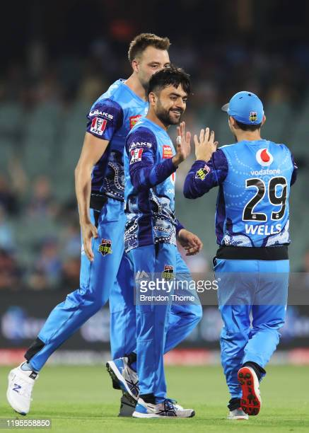 Rashid Khan of the Strikers celebrates with team mates after claiming the wicket of Ashton Turner of the Scorchers during the Big Bash League match...