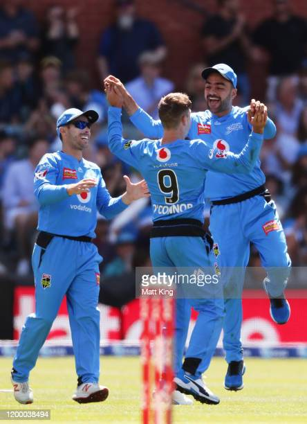 Rashid Khan of the Strikers celebrates with team mates after taking a catch to dismiss Chris Lynn of the Heat during the Big Bash League match...