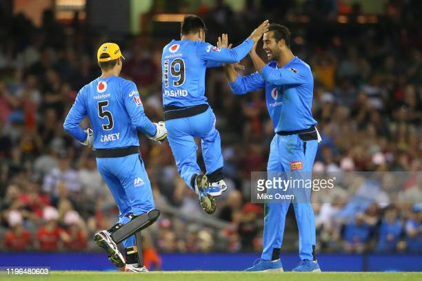 Rashid Khan of the Strikers celebrates with Wes Agar of the Strikers after running out Aaron Finch of the Renegades during the Big Bash League match...