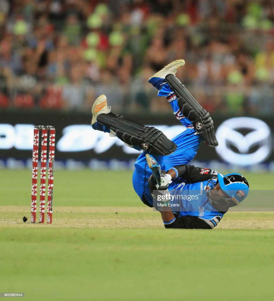 Rashid Khan of the Strikers falls over as he bats during the Big Bash League match between the Sydney Thunder and the Adelaide Strikers at Spotless Stadium on January 7, 2018 in Sydney, Australia.