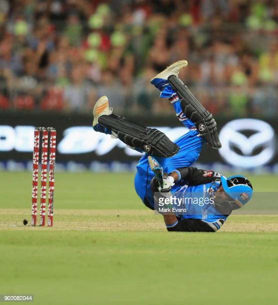 Rashid Khan of the Strikers falls over as he bats during the Big Bash League match between the Sydney Thunder and the Adelaide Strikers at Spotless...