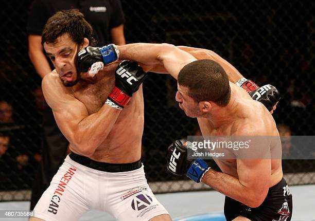 Rashid Magomedov of Russia punches Elias Silverio of Brazil in their lightweight fight during the UFC Fight Night event inside the Ginasio Jose...