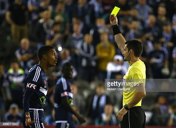 Rashid Mahazi of the Victory is shown the yellow card by referee Jarred Gillett during the round eight ALeague match between Melbourne City FC and...