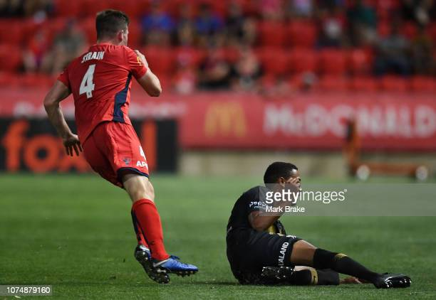 Rashid Mahazi of the Wanderers tackles Ryan Strain of Adelaide United during the round nine ALeague match between Adelaide United and the Western...