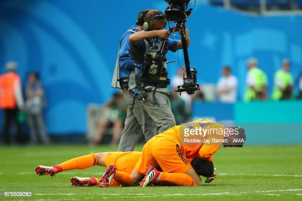 Rashid Mazaheri and Ali Beiranvand of IR Iran celebrate at the end of the 2018 FIFA World Cup Russia group B match between Morocco and Iran at Saint...