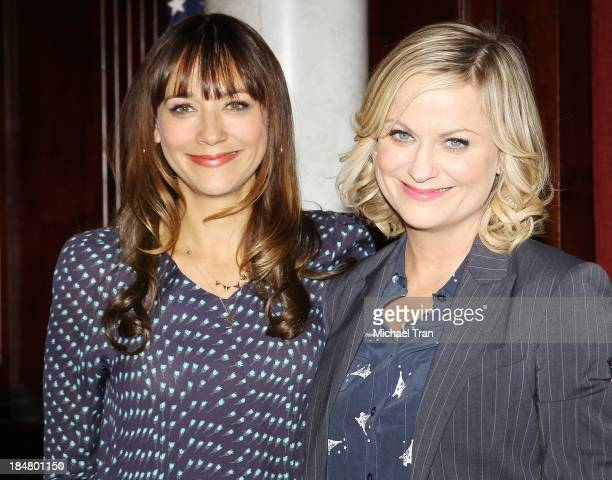 Rashida Jones and Amy Poehler attend the 'Parks And Recreation' 100th episode celebration held at CBS Studios Radford on October 16 2013 in Studio...