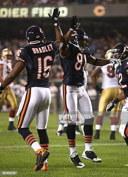 Rashied Davis of the Chicago Bears celebrates a touchdown catch with teammate Mark Bradley against the San Francisco 49ers on August 21 2008 at...