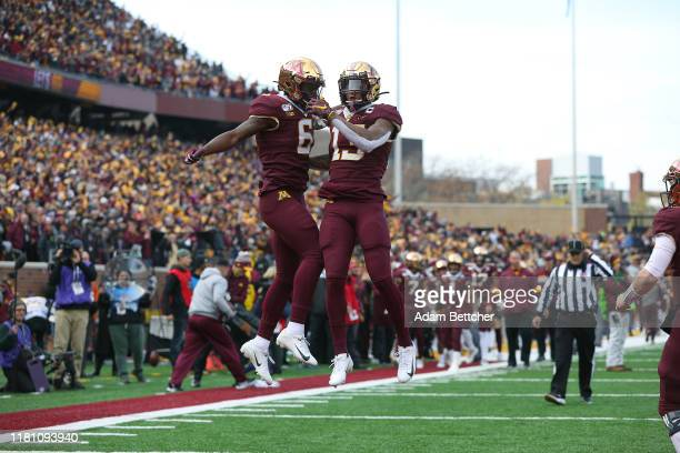 Rashod Bateman of the Minnesota Golden Gophers celebrates his touchdown with Tyler Johnson of the against the Penn State Nittany Lions in the first...