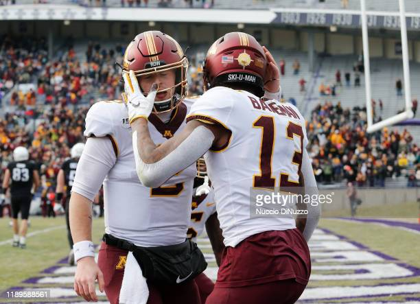 Rashod Bateman of the Minnesota Golden Gophers is congratulated by Tanner Morgan following his touchdown during the second half against the...