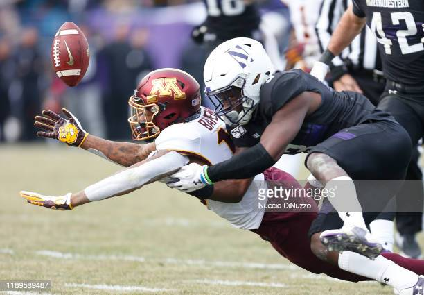 Rashod Bateman of the Minnesota Golden Gophers is unable to catch a pass in front of Trae Williams of the Northwestern Wildcats during the second...