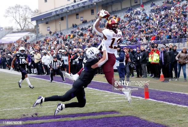 Rashod Bateman of the Minnesota Golden Gophers makes a catch for a touchdown in front of Travis Whillock of the Northwestern Wildcats during the...