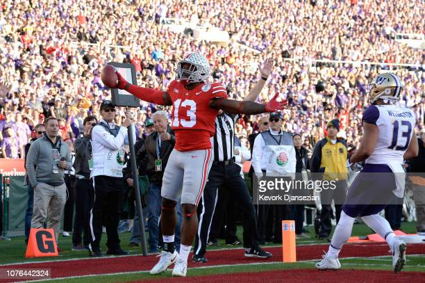 Rashod Berry of the Ohio State Buckeyes celebrates after scoring a 1yard touchdown during the first half in the Rose Bowl Game presented by...