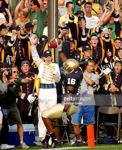 Rashon Powers-Neal of Notre Dame celebrates in the end zone with the Notre Dame Band after scoring a touchdown against Michigan during a game on...